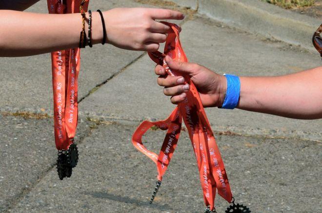 Mel receiving medals for team