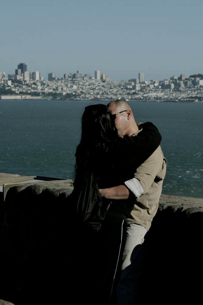 Lovers pose at Golden Gate viewpoint