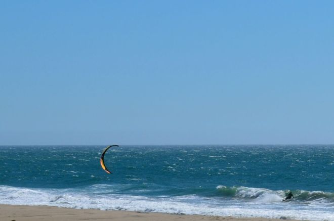Wind surfer dropping in