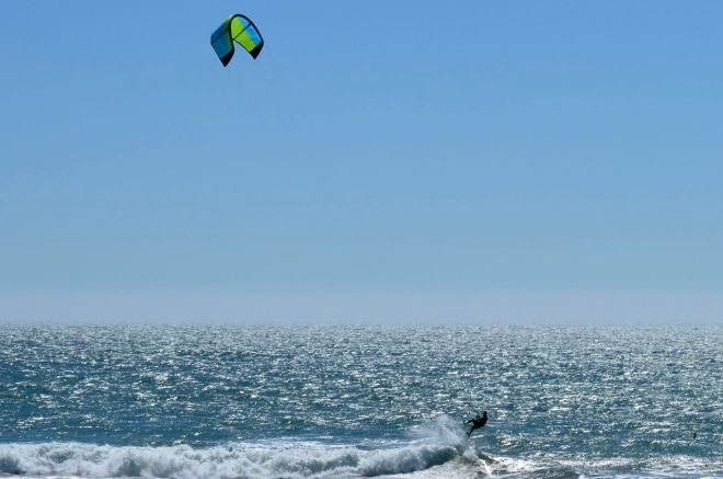 Wind surfer jumping wave