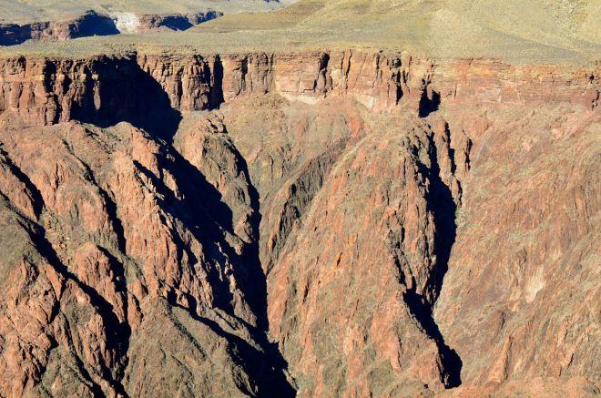 descending below the plateau