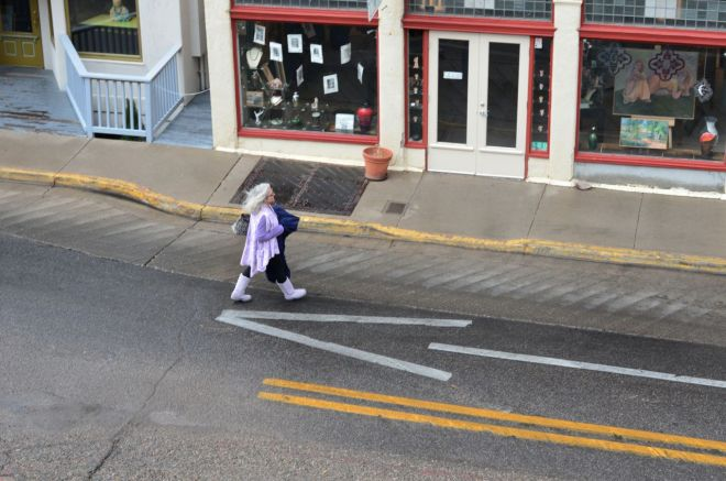 Gray-haired lady on street below