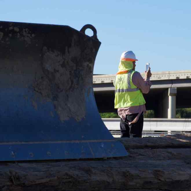 Worker on the Yale Street Bridge